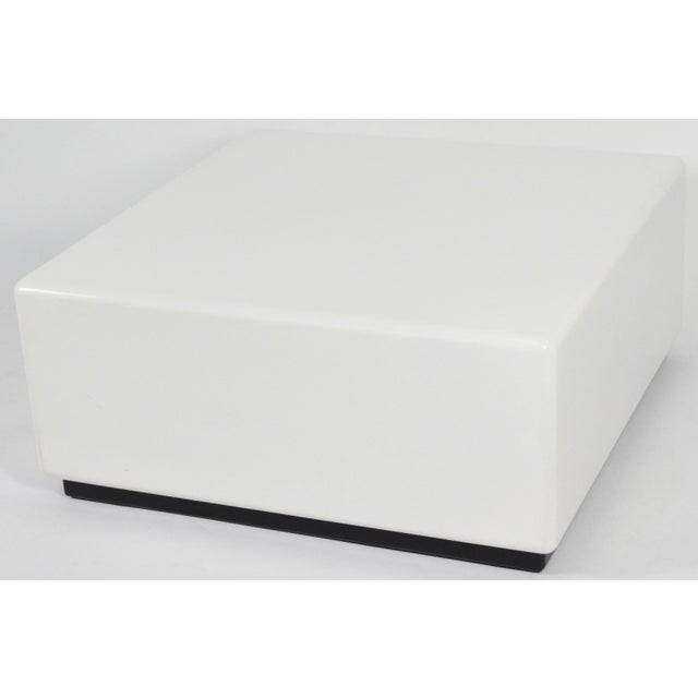 This is a white lacquered coffee table with a black base. Very clean looking!