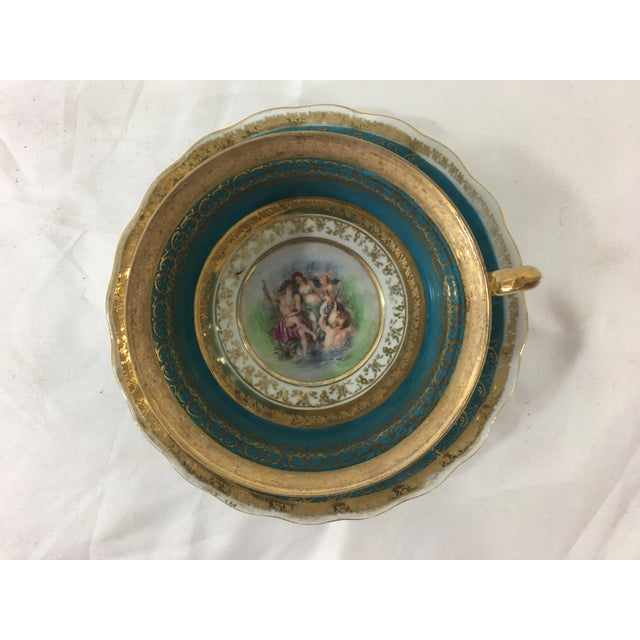 This aqua and gold coffee cup and saucer has the most fabulous design in the bottom, possibly of Neptune and Mermaids.