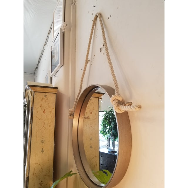 This mirror from Restoration Hardware is framed in solid iron and and tied with thick rope. It's a heavy mirror so you...