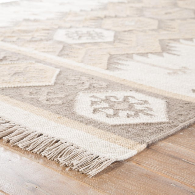 A modern twist on traditional Southwestern style, this flatweave area rug showcases an on-trend geometric design. A gray,...