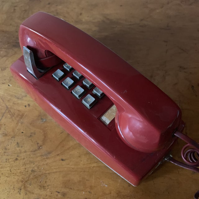 Super fabulous red push button wall phone! It is heavy and sturdy and will look great on any wall or perfect as a TV prop....