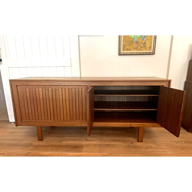 Circa 1960 Norwegian credenza cabinet with adjustable shelving, drawers, and locking skeleton key. In very good vintage...