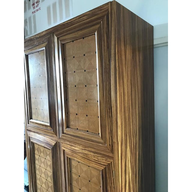 Lucien Rollin Massive Art Deco Style Marquetry Armoire by William Switzer fitted with four bookmatched doors, raised on...