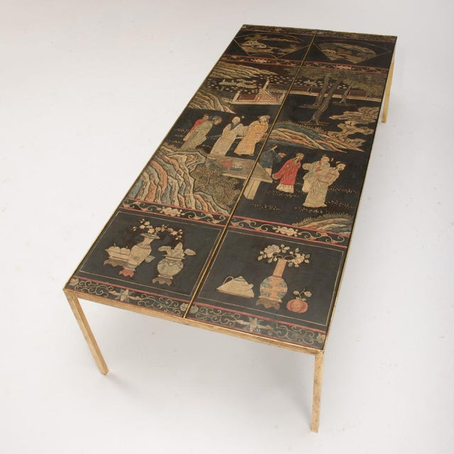 A beautiful gilt and gilt paint rectangular coffee table with chinoiseries panel tops featuring Asian inspired landscapes...