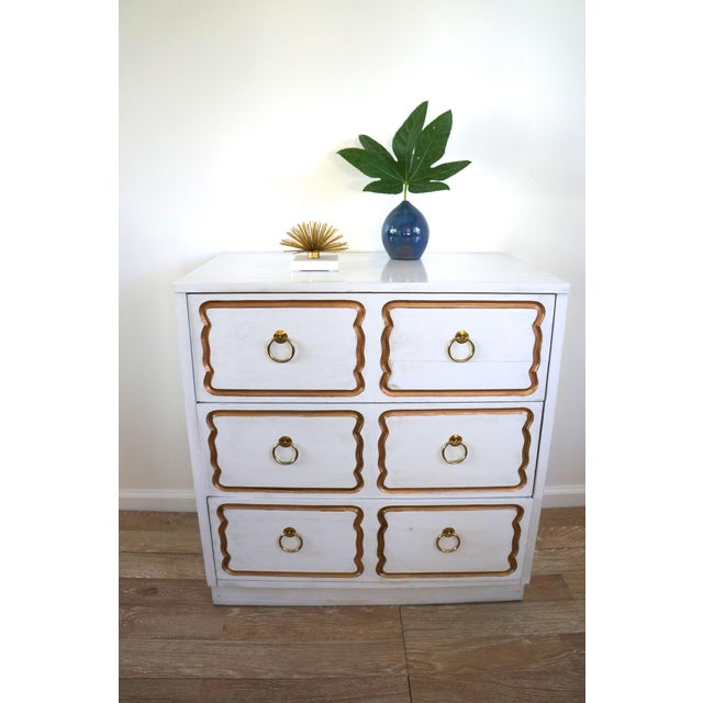 Fabulous Mid Century dresser/ chest in the Dorothy Draper Espana style. White painted surface with antique finish. Three...