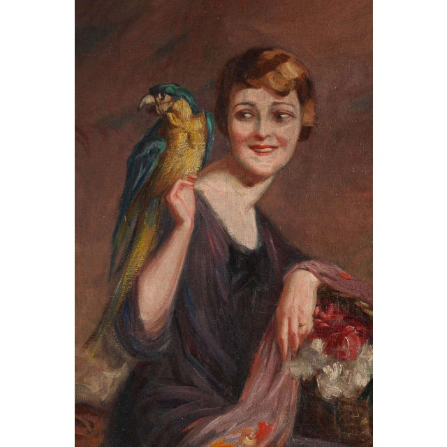 """Pierre Mitiffiot De Bélair (1892-1956).""""Woman with Parrot"""" oil on canvas, circa 1930. Signed lower right, 21 ¾ x 18."""