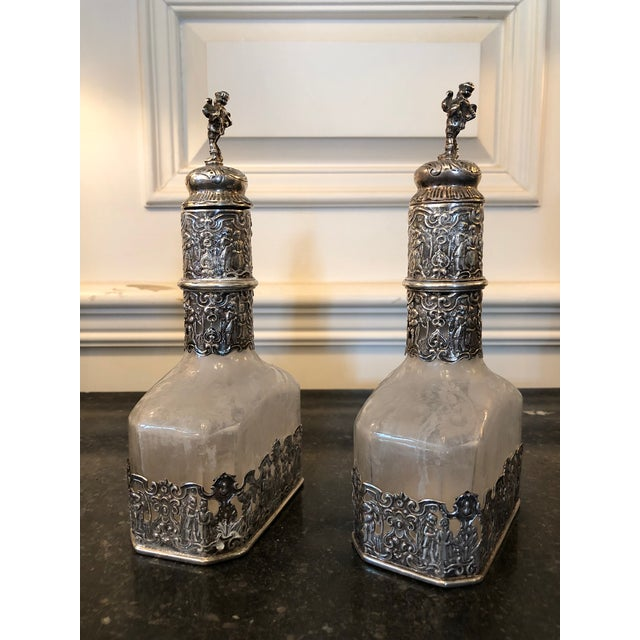 Rare Pair of German Silver Repousse Encased Etched Glass Decanters. Hallmarked on the bottom Augsburg 1781-1783. Fine...