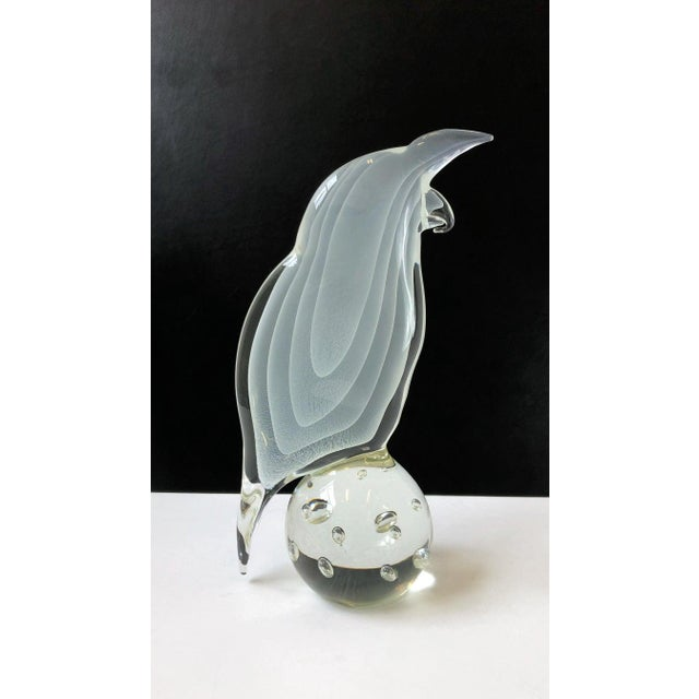 A beautiful Italian white and clear Murano glass bird sculpture by Licio Zanetti for Ultima Crystal Art. The sculpture is...