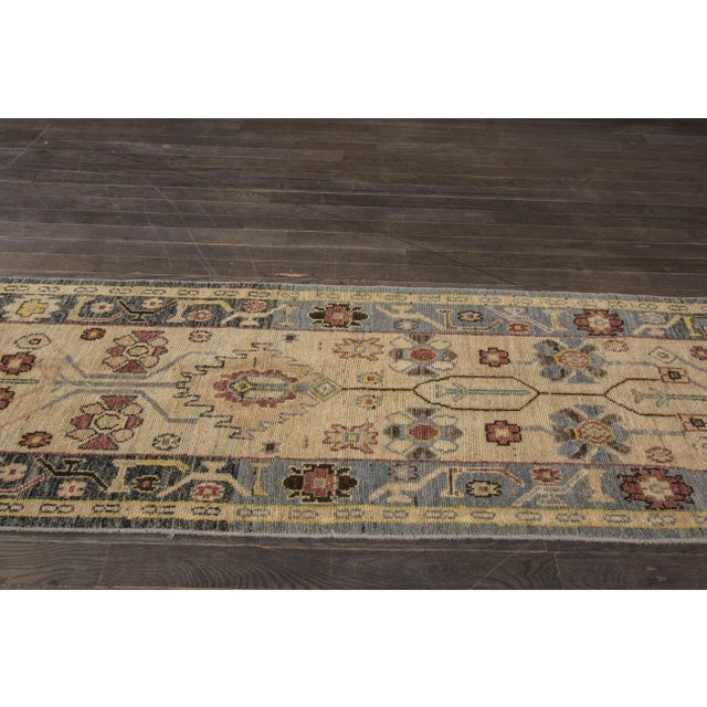 A hand-knotted Oushak rug with a floral design. This rug has magnificent detailing and would be a perfect addition to your...