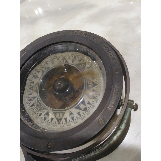 Vintage Kelvin White Boston brass ships compass. Filled with water. has Rust all over. Not sure if it's still accurate....