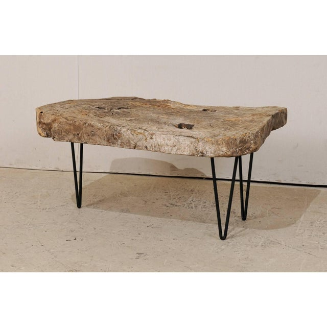 A custom coffee table of old Spanish wood. This rustic yet chic coffee table is made up from the top of a 19th century...