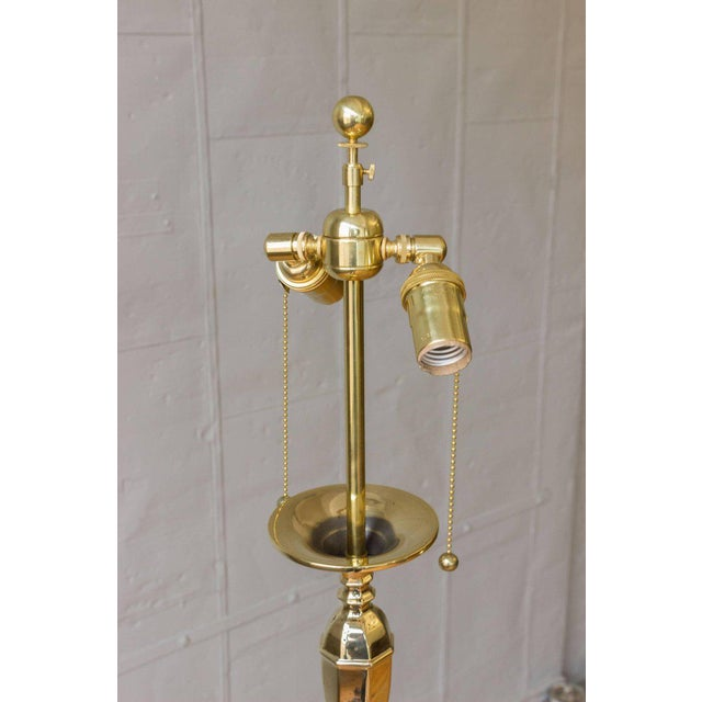 An exceptional neoclassical style floor lamp from France composed of individual turned pieces on a hexagonal shaped base....