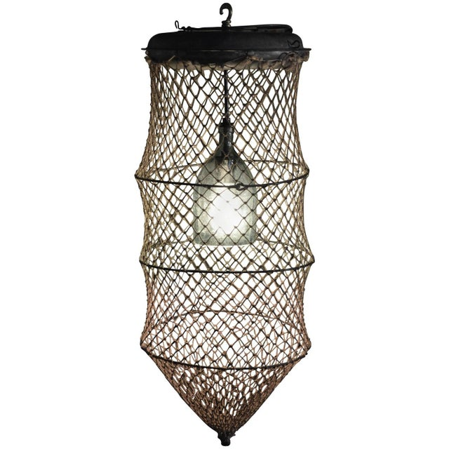 Pendant Light From Seltzer Bottle Inside Fish Trap - Image 1 of 10