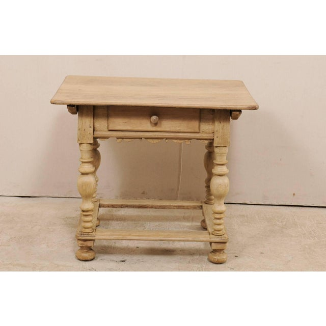 An 18th century Swedish period Baroque wooden side table. This antique Swedish occasional table features an overhanging...