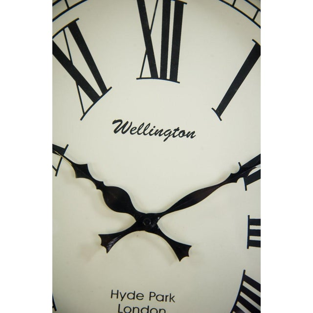 Bring a sophisticated, nautical feel to your beach house getaway with this Colomore Wellington wall clock with a black...