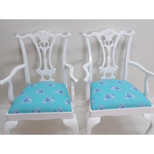 Striking pair of side arm chairs, completely reinvented! These chairs feature cabriole legs, ball and claw feet, Carved T...