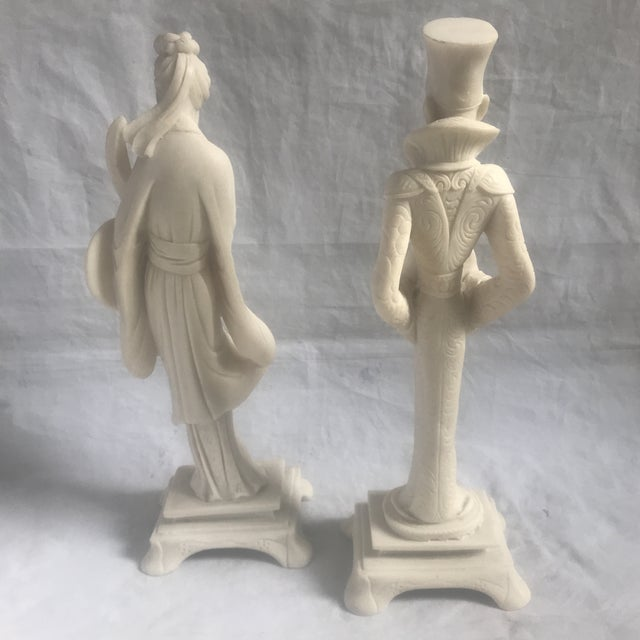 Wonderful pair of Asian/chinoiserie style figurines in molded resin are likely circa mid twentieth century. This lovely...