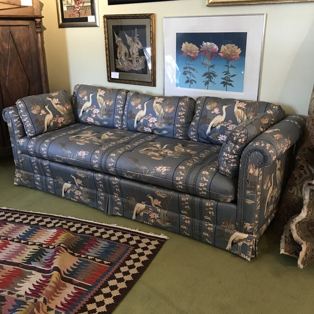Vintage Drexel sofa with blue-gray upholstery featuring herons and lotus. Long and low, single cushion, rolled arms, 6...