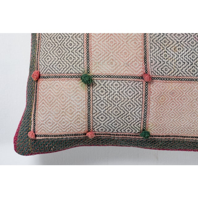 Vintage cotton storage bag reconfigured into a pillow. Geometric embroidery pattern and pompoms. Natural linen back,...