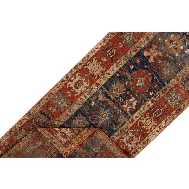 Vintage hand-knotted Persian Bakshaish Runner with a tribal design. This piece has fine details, great colors, and a...