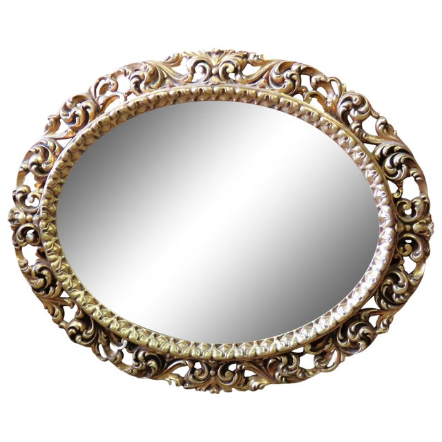 Gilt Carved Oval Mirror For Sale