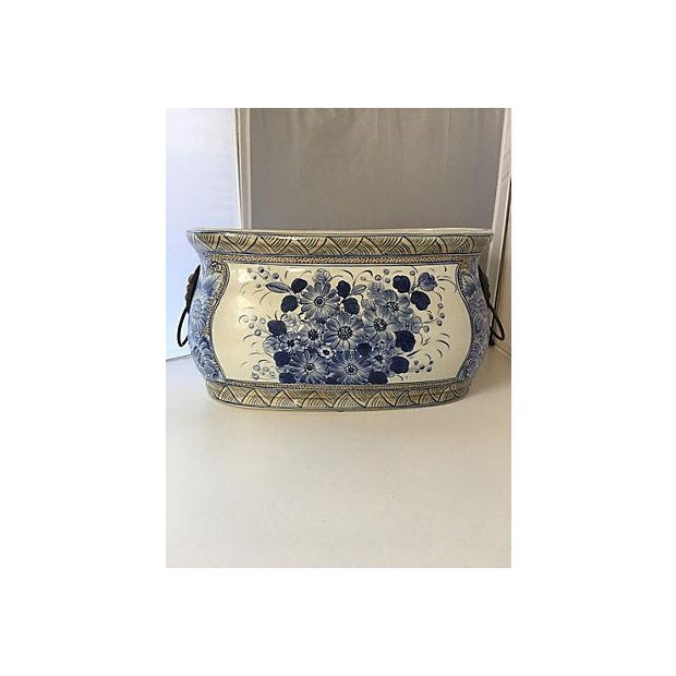 """Monumental blue and white painted planter centerpiece with lion's head ring detail on sides. Marked """"Maitland Smith."""""""