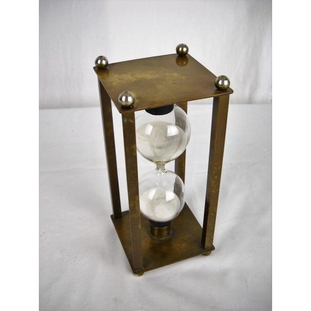 Mid-Century Modern petite brass 12-minute hour glass. No maker's mark.