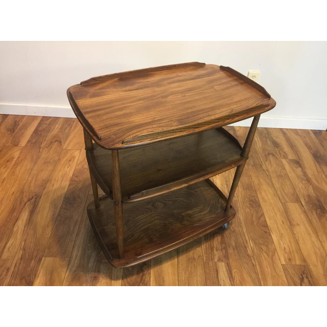 This rolling bar cart/tea trolley was designed by Lucian Ercolani in the 1950s and was produced by his company Ercol in...