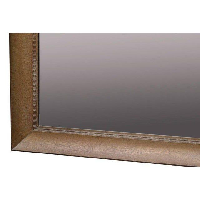 1950s large square wall or dresser mirror made by James Mont. The mirror has the original gold finish and shows some...