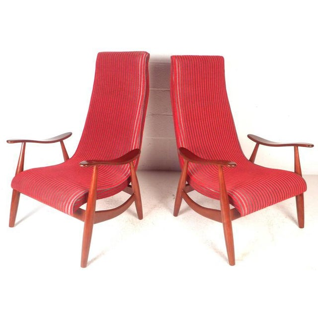 This beautiful pair of vintage modern lounge chairs feature a solid walnut frame with sculpted arm rests. Sleek design...