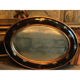 Vintage Chinoiserie Gold Bamboo Leaves on Convex Black Frame With Antiqued Oval Smoky Mirror Preview