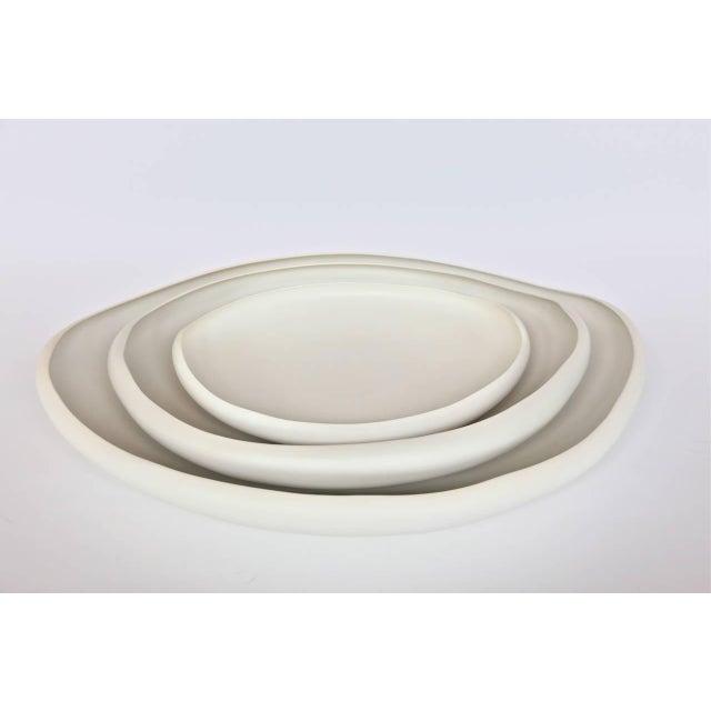 "Italian handmade ceramic tray in white by Rina Menardi. Mini $495 (depth 14.25"", width 16.5"") Small $880 - (Height 3.15"",..."