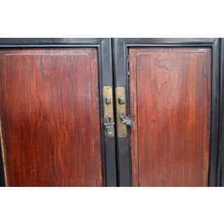 Chinese Early 20th Century Black and Brown Wood Armoire With Doors and Drawers Preview