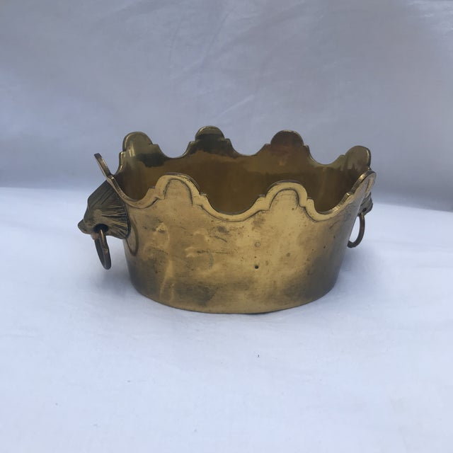 This wonderful solid brass planter with beautiful raised scalloped rim and lion's head handles.