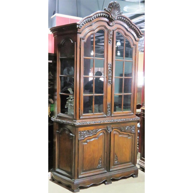 Carved mahogany frame. Glass doors. Small damages to mouldings. Light wear.