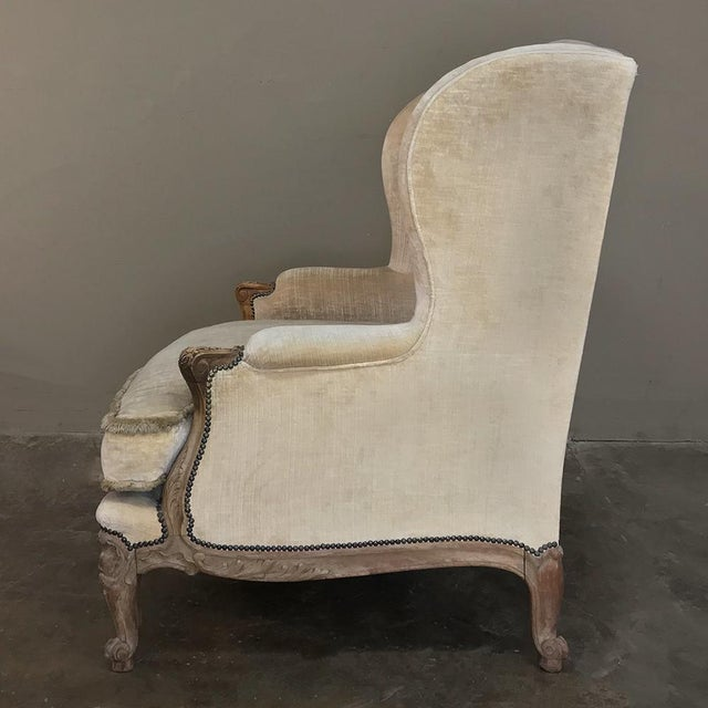 Wood Antique French Walnut Louis XV Wingback Armchair For Sale - Image 7 of 13
