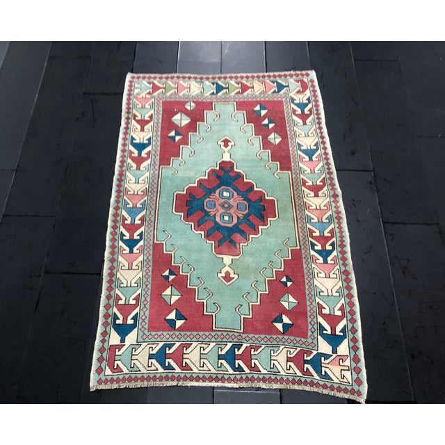 Handknotted designer red and turquoise color antique area rug material : natural wool & cotton