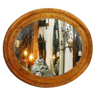 Mirror in Oval Carved Frame For Sale
