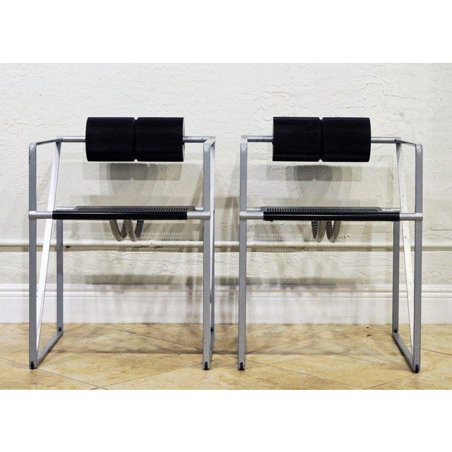 This chair by Mario Botta has become a design icon representing the late 20th century modern and Postmodern movement. The...