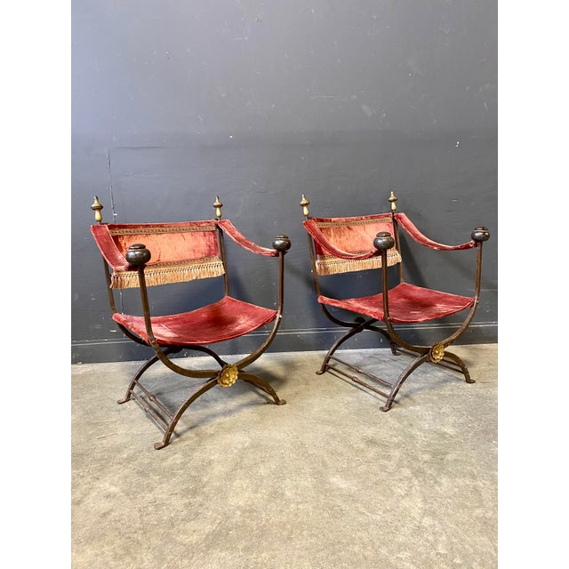 Beautiful iron and velvet Italian 19th Century campaign chairs. Very rare find and a beautiful addition to your home....