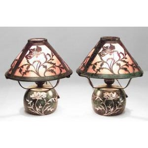 Pair of American Mission bronze green patina boudoir table lamps with floral silver deposit on base and filigree mica...