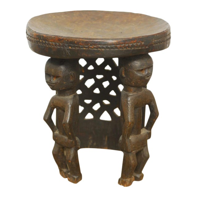 African Carved Tribal Stool with Figural Legs For Sale