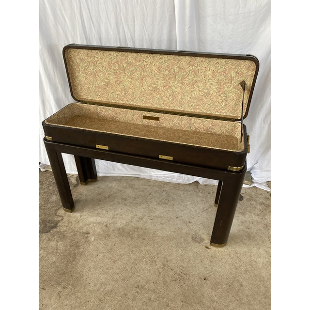 Beautiful and unique two piece console by Maitland-Smith all leather wrapped with brass campaign fittings and handle. I...
