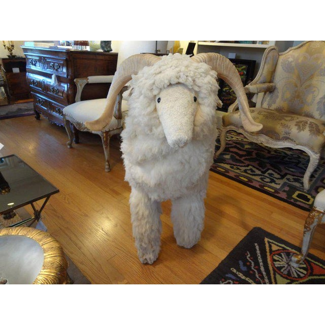 Large realistic sheep or lamb sculpture or bench made of wood and covered with real sheep fur and horns in the manner of...