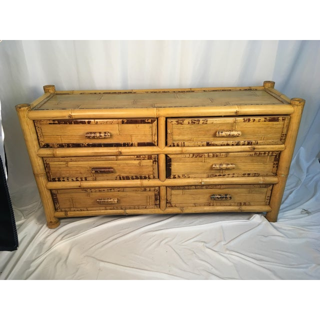 Stunning vintage dresser made of bamboo. This is a special piece that you will never get tired of! The nightstands are...
