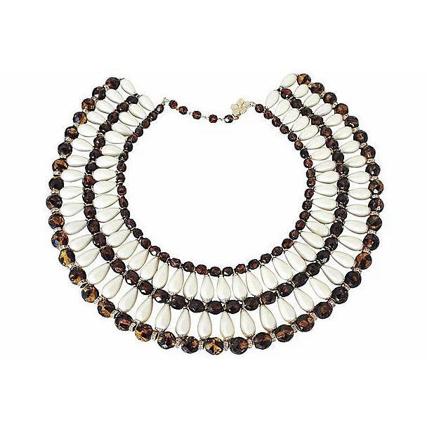 """1960s goldtone resin faux-pearl and faux-tiger's eye bead bib necklace with floral hook closure. Marked """"Vendome.""""..."""