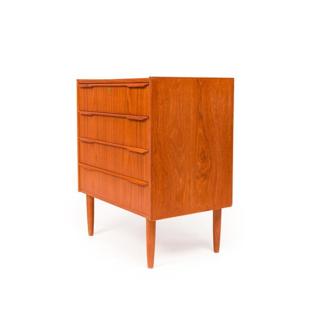 This vintage Danish Mid Century Modern four-drawer teak chest is an excellent piece for nightstand, dresser, entryway...