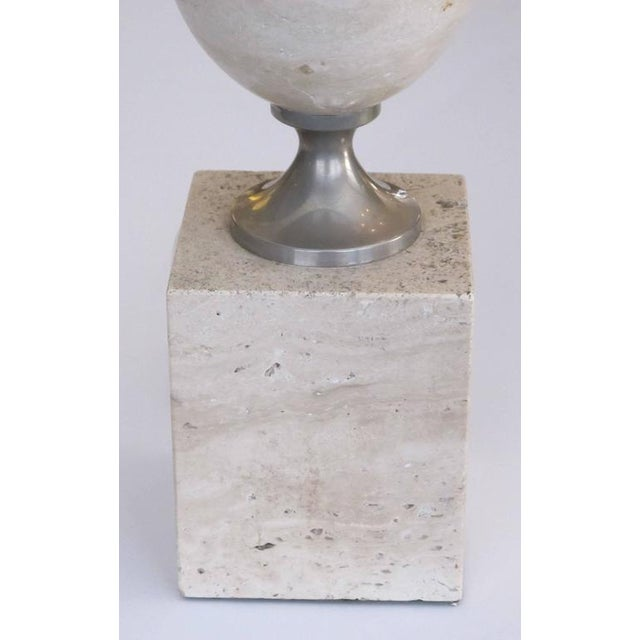 A good French 1970s Philippe Barbier polished travertine and chrome lamp; the ovoid lamp over a square plinth joined by...