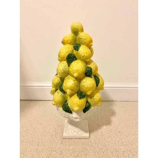 Made in Italy, this towering topiary features bright lemons in a fluted basketweave white bowl with lion heads decorating...