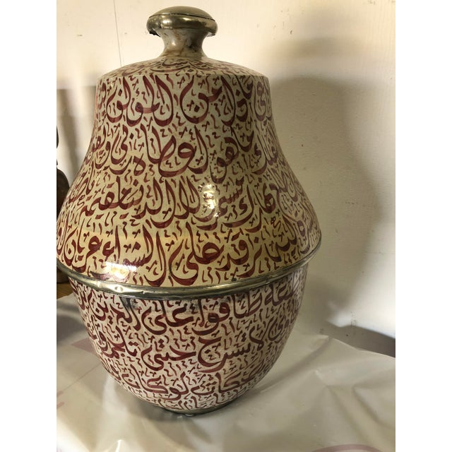 This pot from Fez, Morocco features hand painted artistry with fine details, deep colors, and a variety of hand spun designs.
